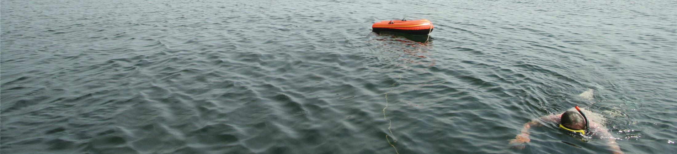 Man snorkeling in lake